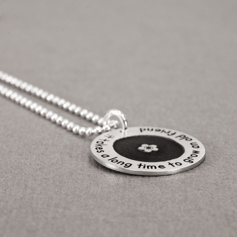 Silver Etched Flower Forever Love Circle Necklace personalized with your names or words, shown from the side