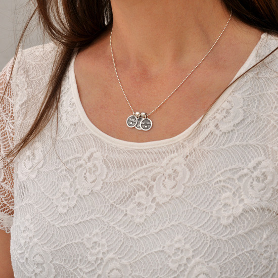 Custom silver Mom Necklace, personalized with kids names, shown on model