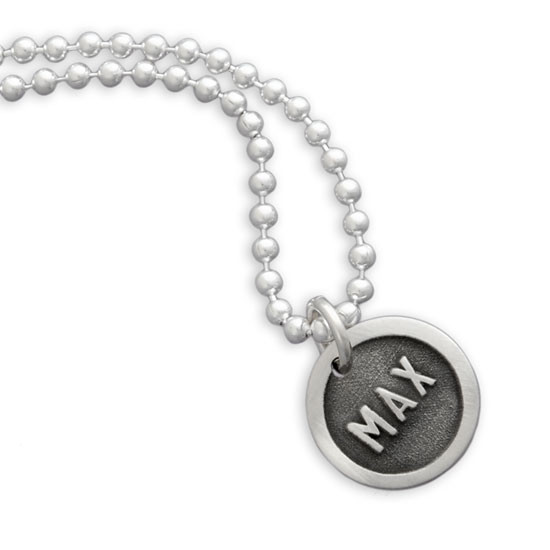 Silver Etched Name Disc Necklace personalized with dog name, shown close up on white