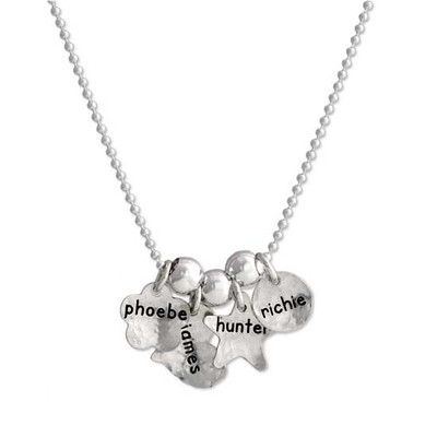 Custom silver Mom necklace, personalized with kids' names hand stamped on silver charms, shown on white