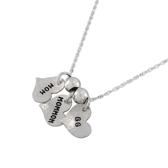 Custom silver Family Tags Mommy necklace, personalized with kids' names hand stamped on five silver charms, shown on white