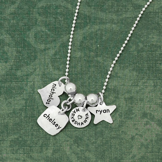 Custom silver Family Tags Mommy necklace, personalized with kids' names hand stamped on four silver charms, shown with different shaped tags