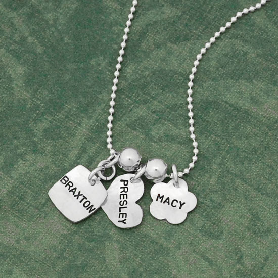 Custom silver Family Tags Mommy necklace, personalized with kids' names hand stamped on 3 silver charms, shown with different shaped tags