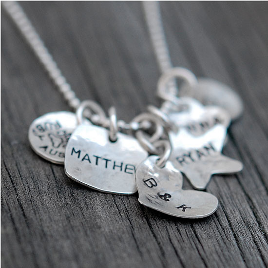 Custom silver Family Tags Mommy necklace, personalized with kids' names hand stamped on five silver charms, shown with 6 charms