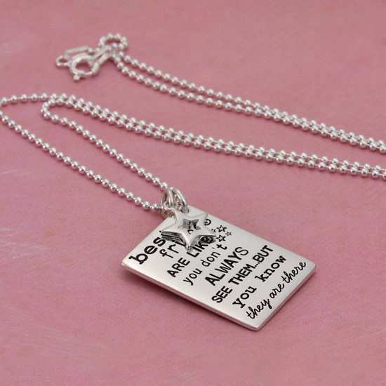 "Side view of silver custom best friends necklace, with ""Friends are Like Stars"" hand stamped on the front"