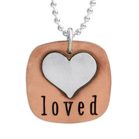 Hand stamped Fused Heart and Copper Necklace with silver heart, shown close up on white