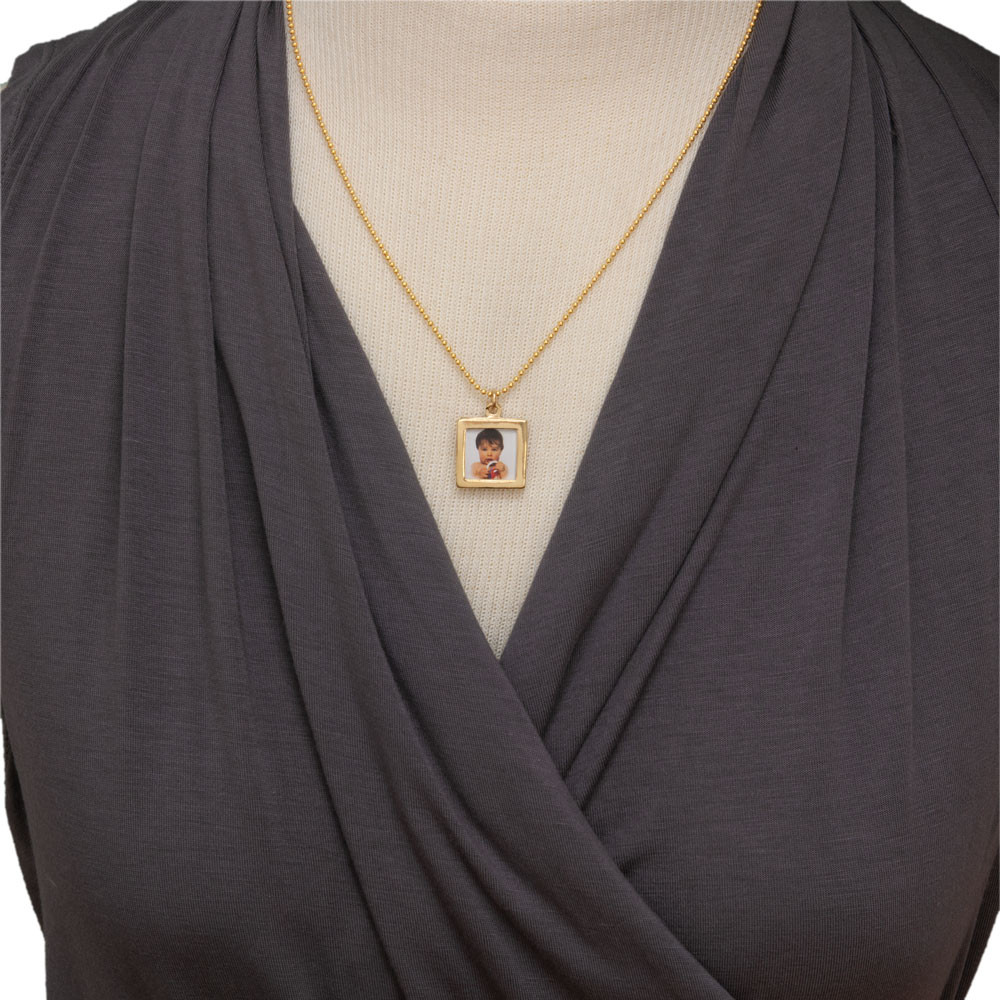Gold Double-sided Photo Frame Necklace, shown on a model