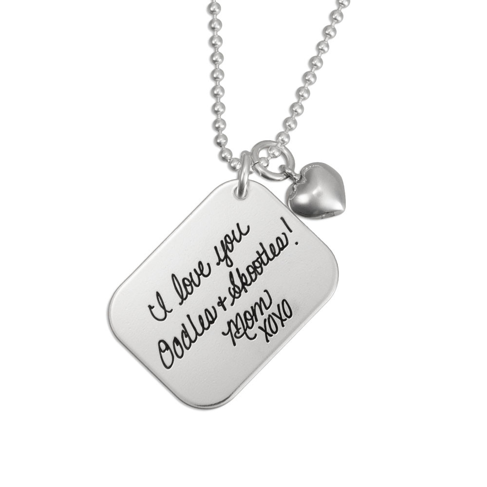 Love Letter Handwriting Silver Necklace, with a silver puffed heart charm, shown close up on white