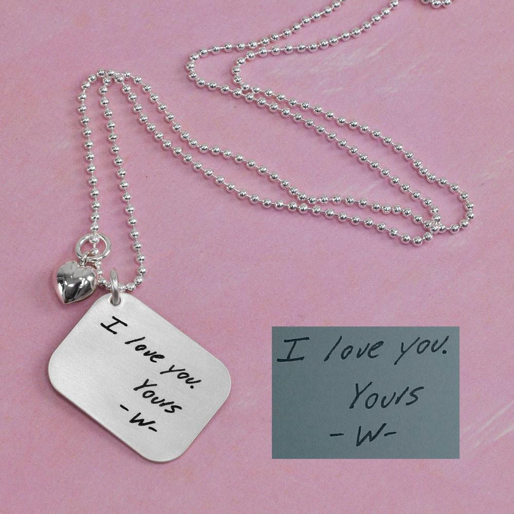 Handwritten love letter on a pendant