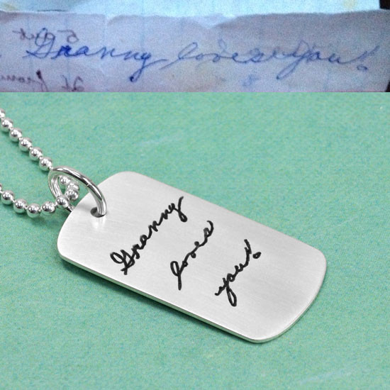 Custom silver dog tag necklace with child's handwriting, with the original handwritten note used to create it