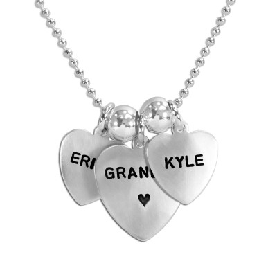 Grandma silver heart custom necklace hand stamped with kids names, shown close up on white