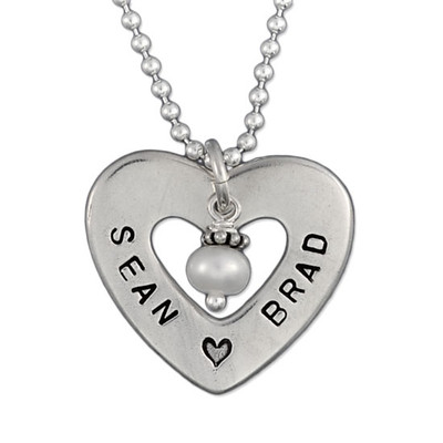 Close up of Hand Stamped Heart of Love Necklace, showing personalization
