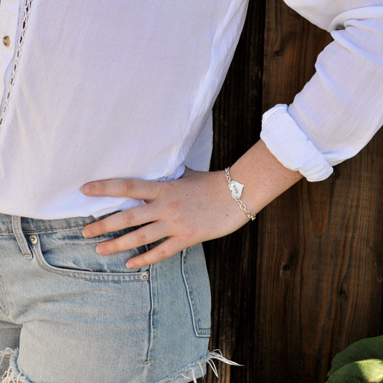 Hand Stamped Sterling Silver Mommy Bracelet, shown on a model