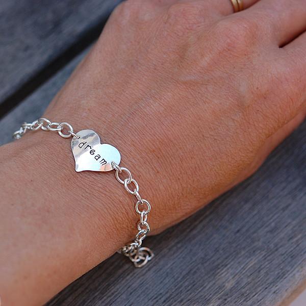 Hand Stamped Sterling Silver Mom Bracelet shown on a model