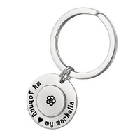 Custom Large Double Disc Key Ring in sterling silver, stamped with names and symbols, shown on white