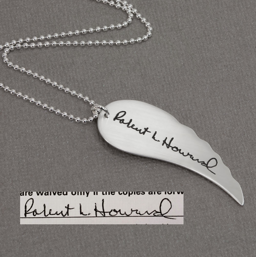 Large Handwriting Memorial Charm Angel Wing in silver, shown close up with the original signature used to create it