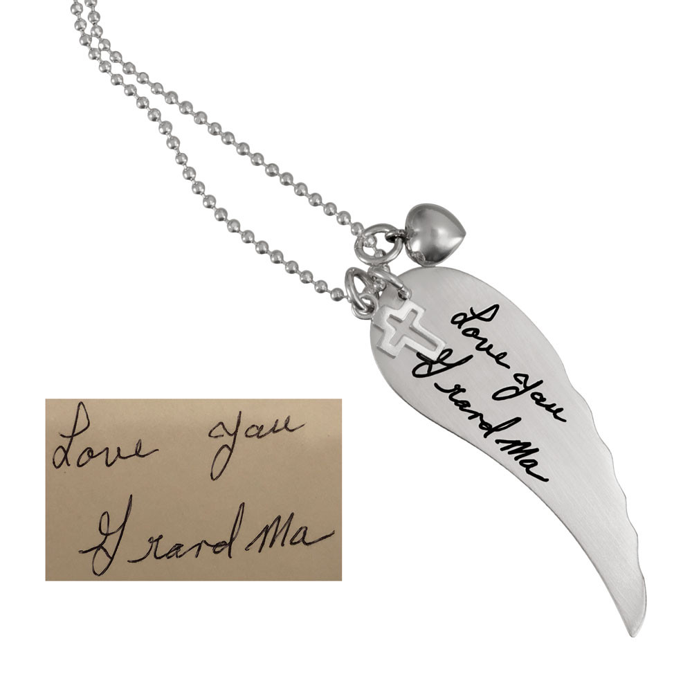 Large Handwriting Memorial Charm Angel Wing in silver, with a silver puffed heart, shown close up on white, with the original handwriting used to create it