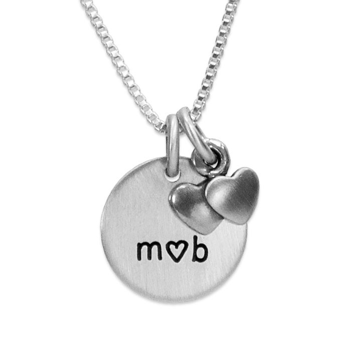 Silver hand stamped Me and You Necklace with initials, shown close up on white background
