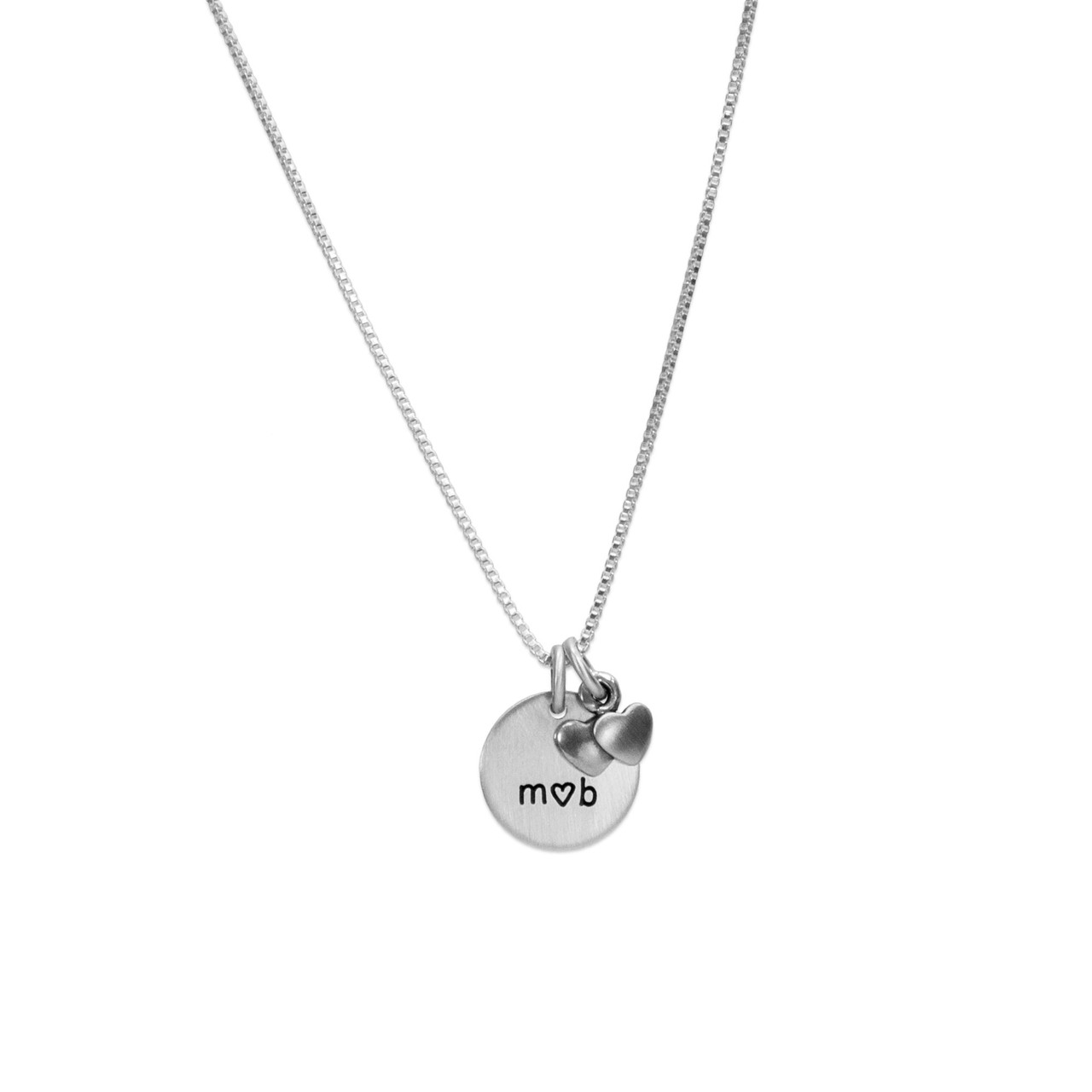 Silver hand stamped Me and You Necklace with initials, shown on white background