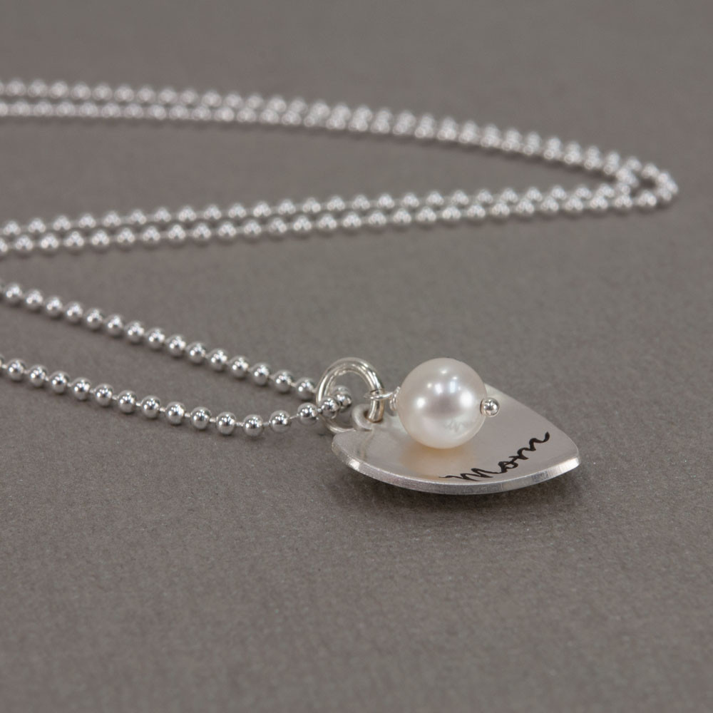 Silver Mom Heart with Pearl hand stamped custom necklace, shown from the side