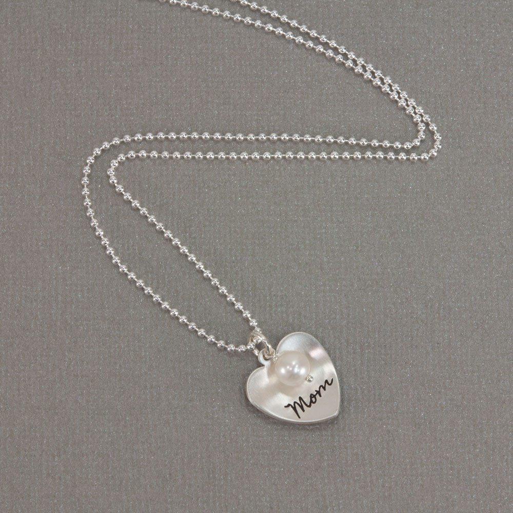 Silver Mom Heart with Pearl hand stamped custom necklace, shown from the top