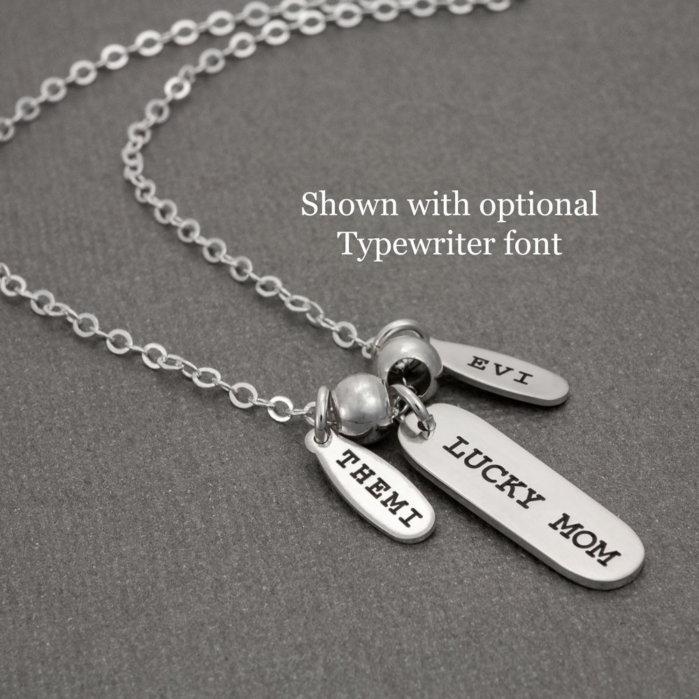 Silver Mom Tags Necklace, stamped with kids names, shown stamped in typewriter font
