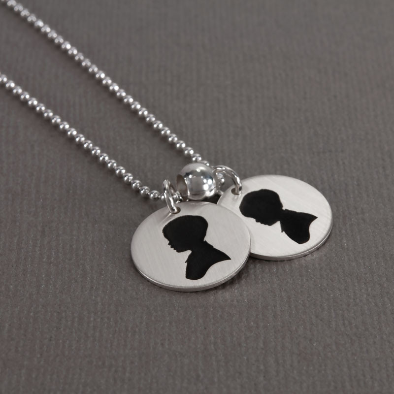 My Child's Cameo Necklace custom made in sterling silver from your child's actual photo, shown from the side