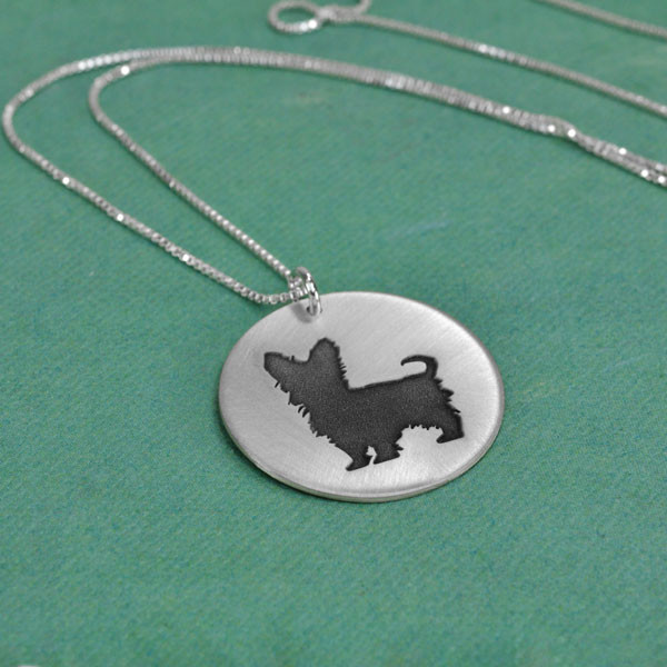 Sterling silver circle necklace with silhouette of Yorkie dog, shown from the side