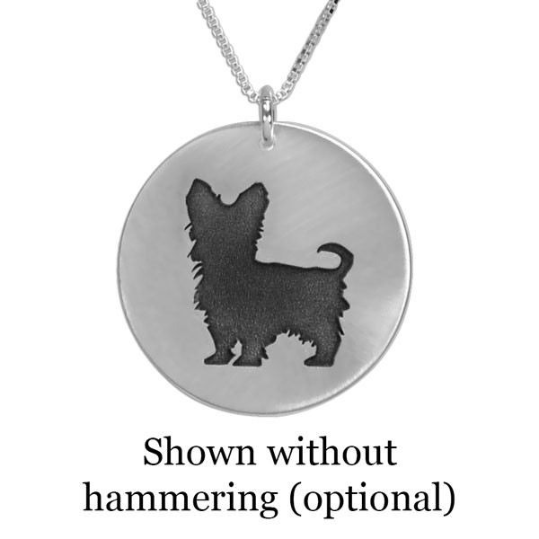 Sterling silver circle necklace with silhouette of Yorkie dog, shown close up on white background