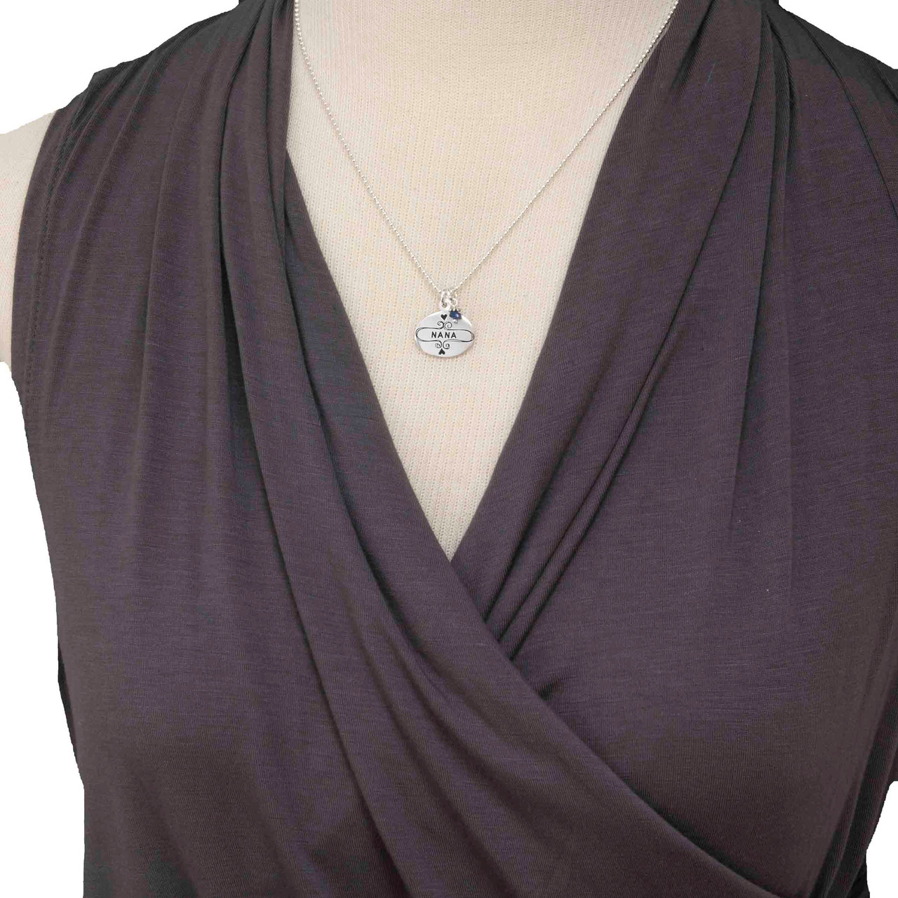 Sterling Silver Nana Necklace, shown with birthstone close on a model