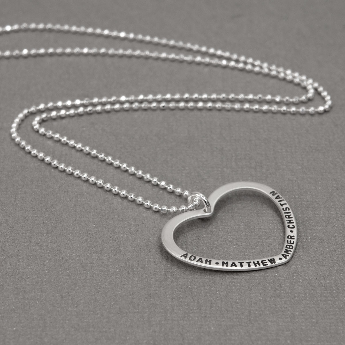 Open Heart Charm Silver Necklace, shown from the side