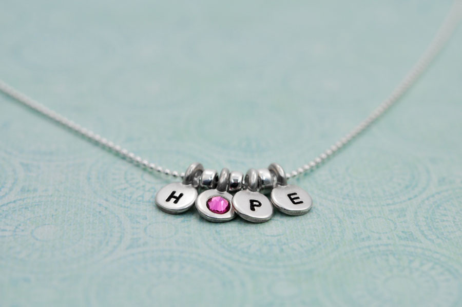 Side view breast cancer necklace
