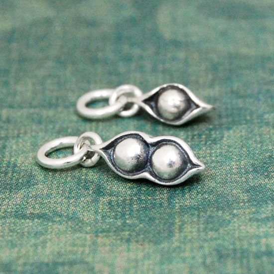 Silver Peas In A Pod Charm, shown close up from side