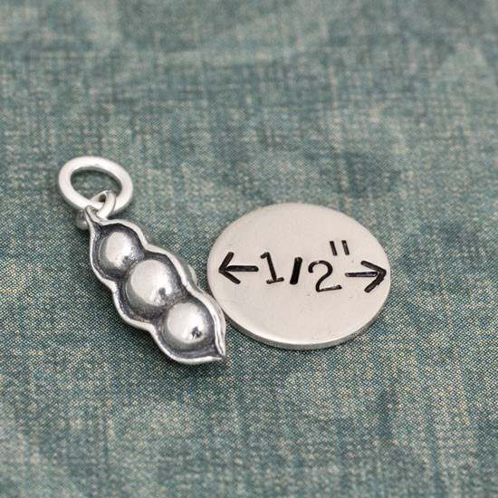 Silver Peas In A Pod Charm, shown close up with a charm for perspective