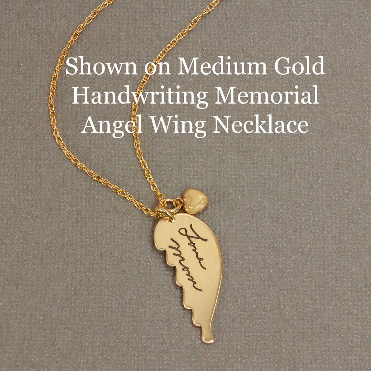 Puffed Heart shown on Gold Handwriting Angel Wing Necklace