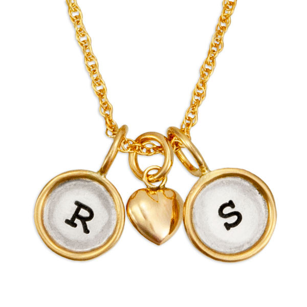 Mini rounds with initials on gold chain, shown on white, close up