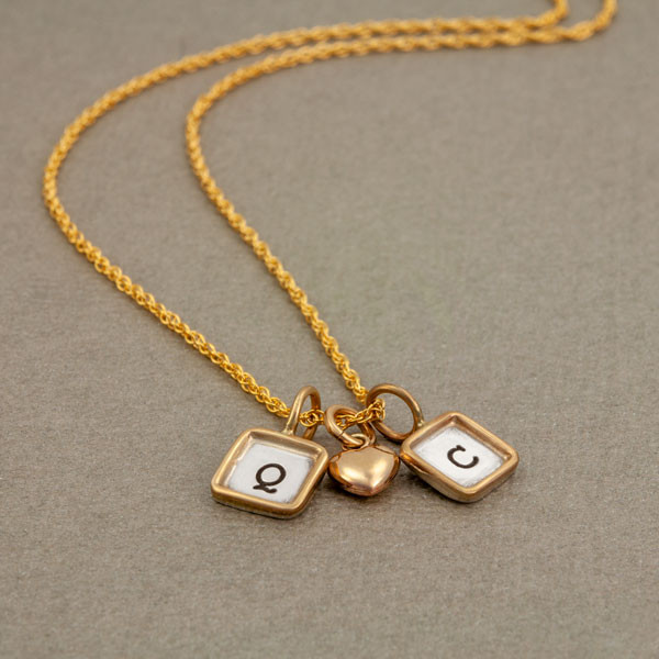 Mini squares with initials on gold chain, shown from the side