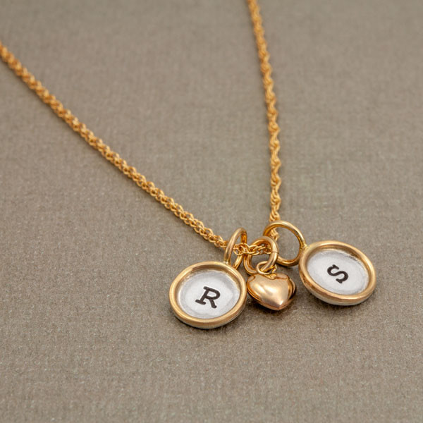 Mini rounds with initials on gold chain, shown from the side