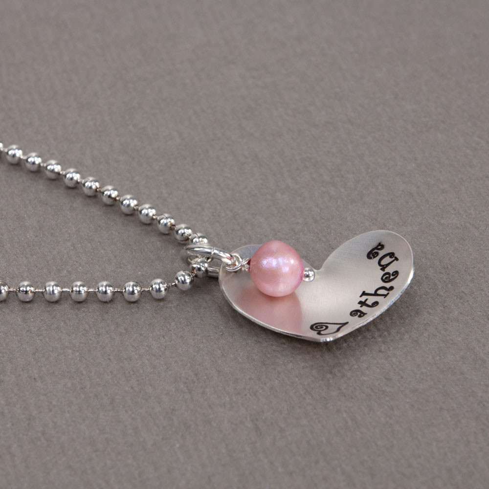 Scooped Silver Heart with Freshwater Pearl custom necklace, hand stamped with kid's name,  shown from the side