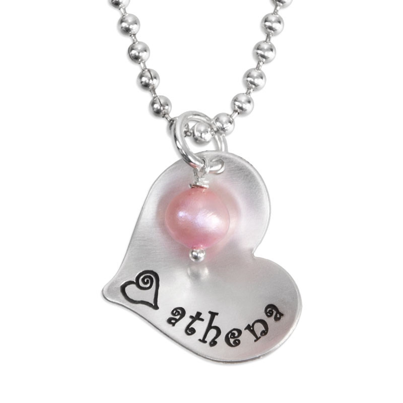 Scooped Silver Heart with Freshwater Pearl custom necklace, hand stamped with kid's name, shown on white
