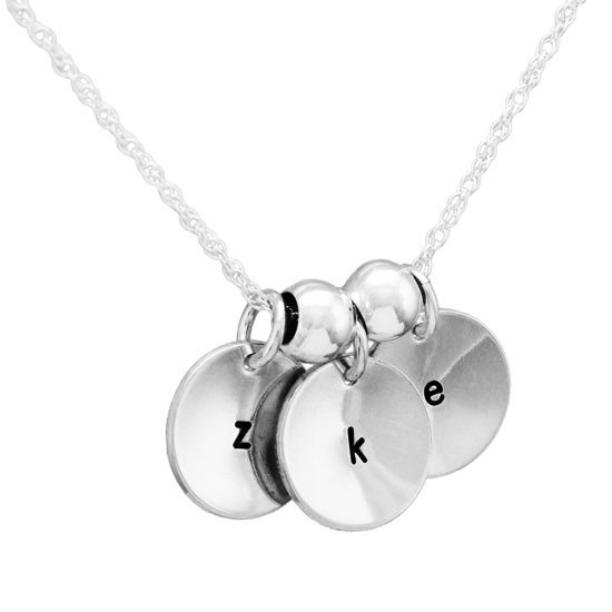 Custom Hand stamped sterling silver discs, personalized with initials, stylishly scooped/cupped for extra dimension, shown on white