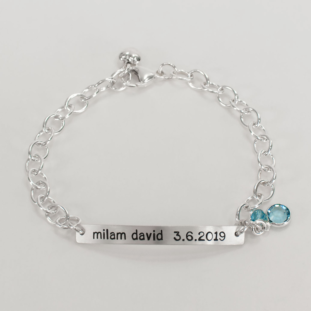 Hand stamped ID Bracelet made from sterling silver, shown with birthstone from the top