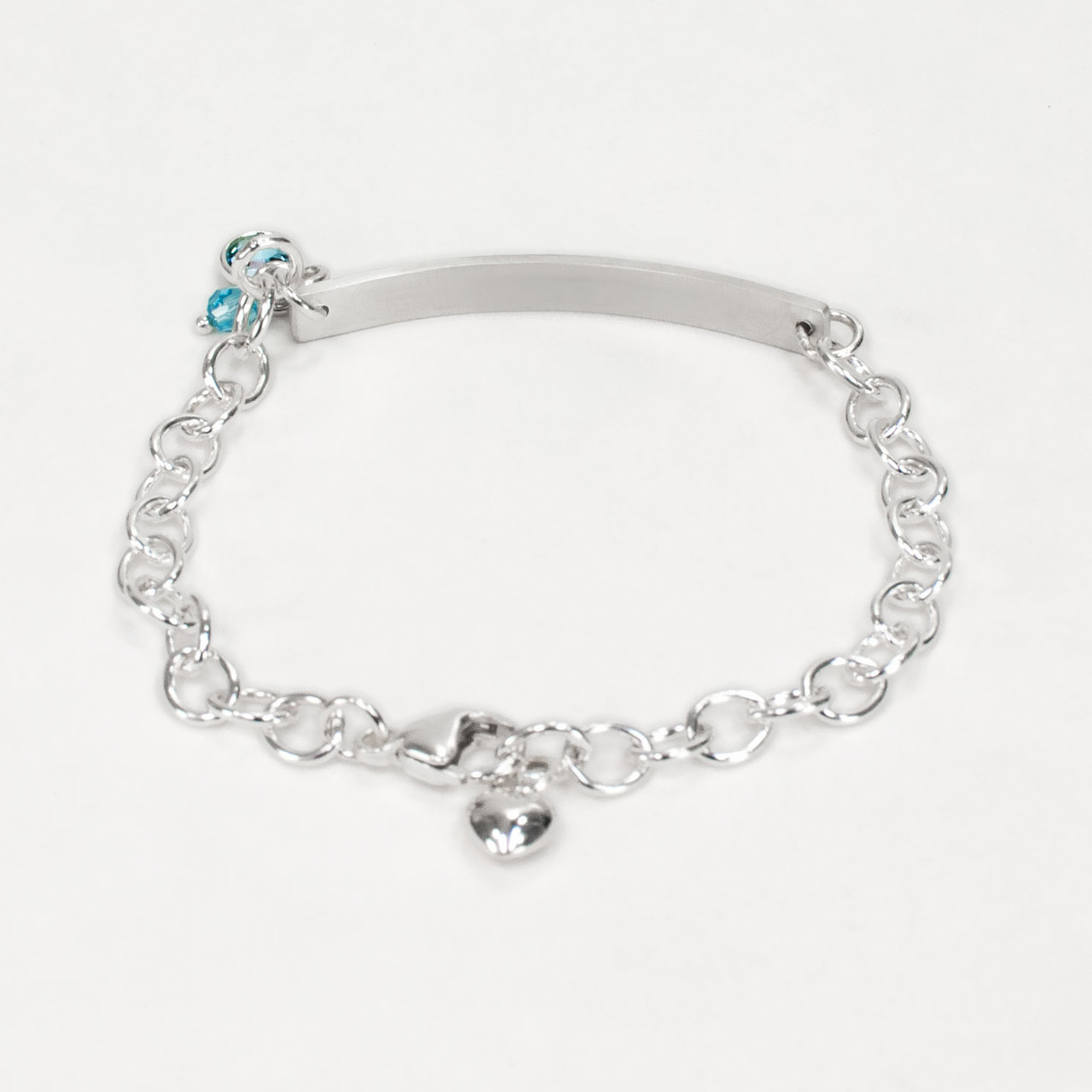 Hand stamped ID Bracelet made from sterling silver, shown from the back, with birthstone on white