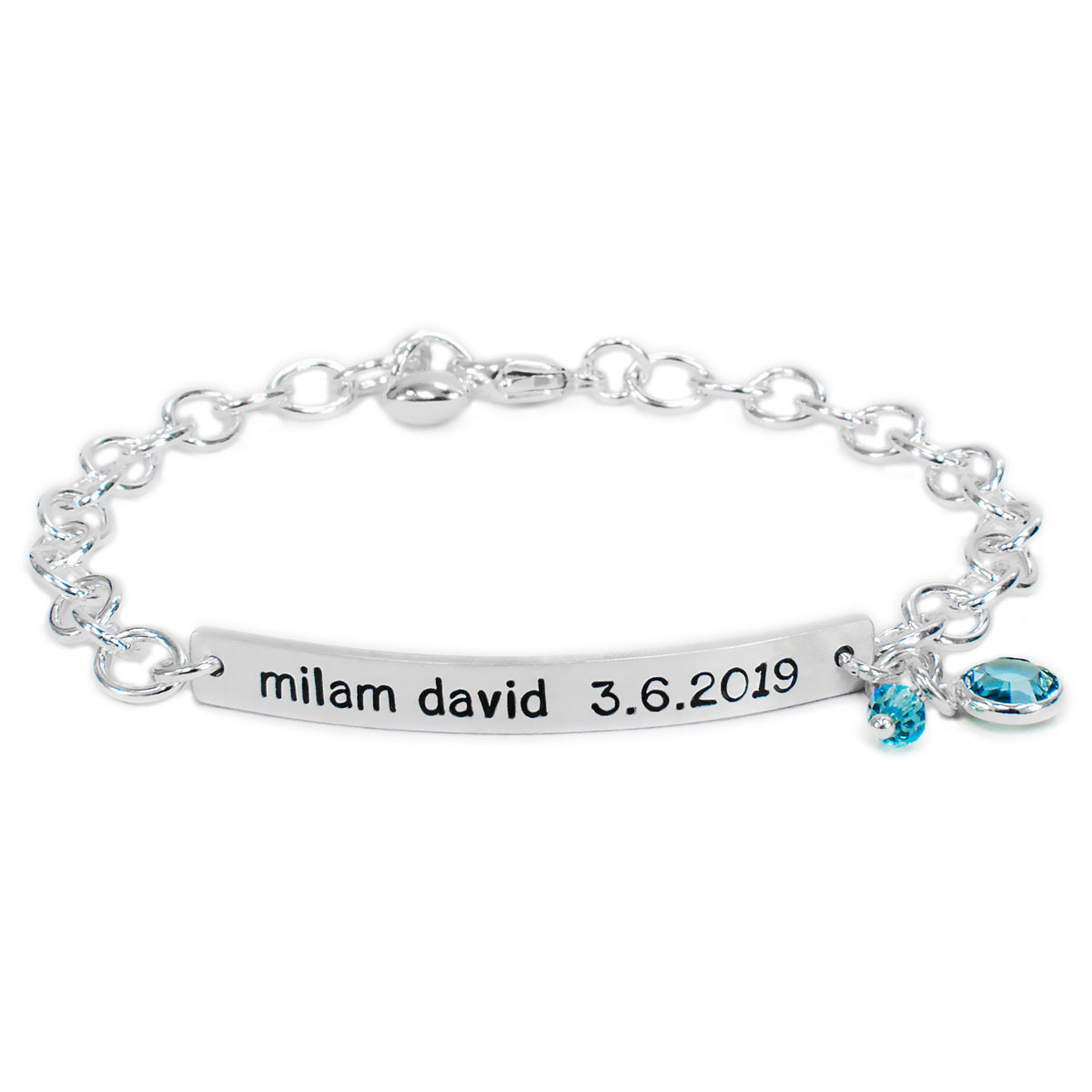 Hand stamped ID Bracelet made from sterling silver, shown with birthstone on white