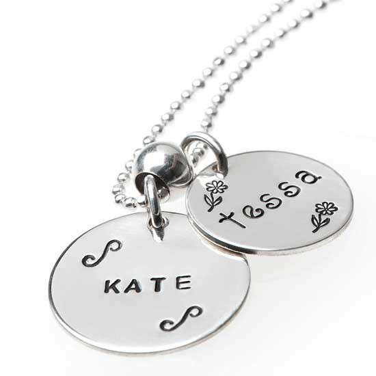 "Our 3/4"" and 5/8"" sterling hand stamped name discs. Block font and Lower Kissme"
