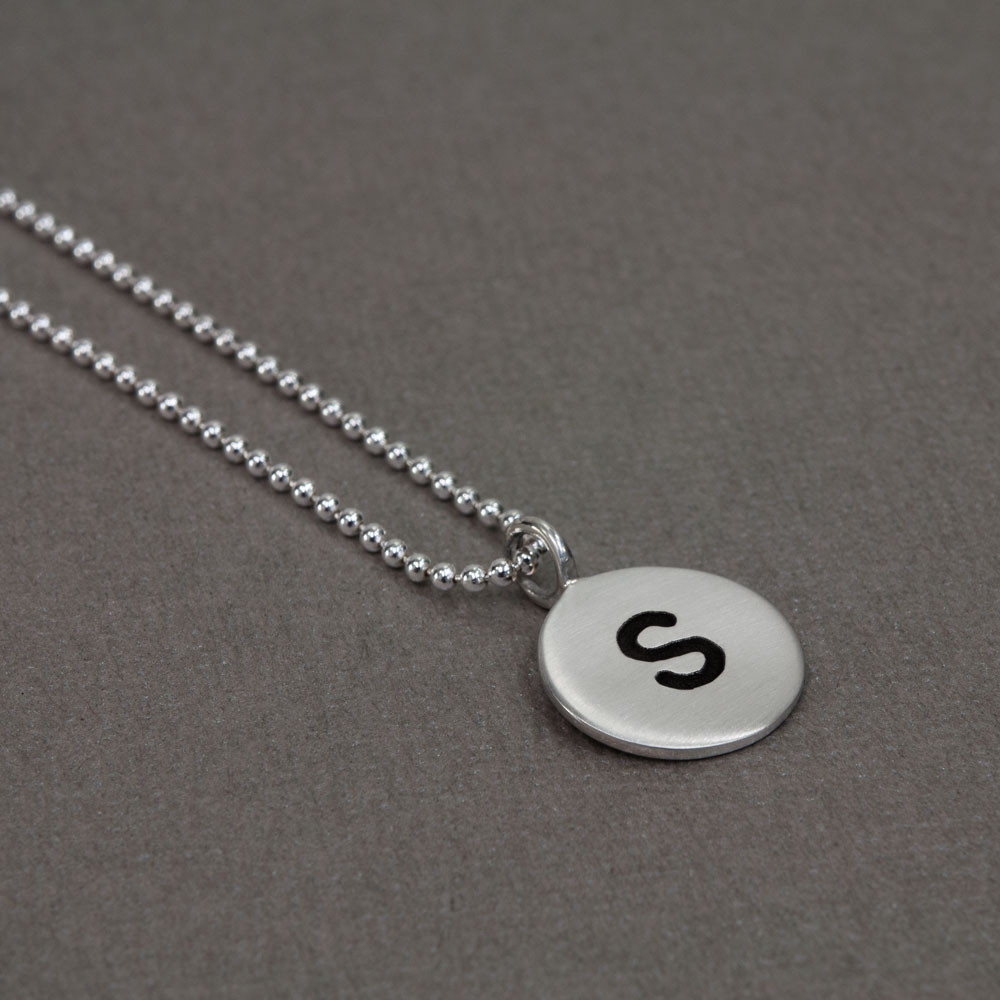 Hand stamped custom Sterling Silver Initials Necklace, shown from the side