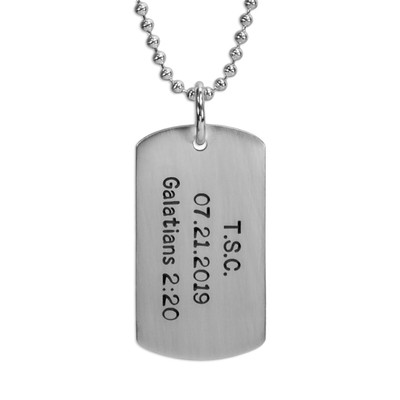 Custom hand stamped sterling silver military dog tag, personalized with names or phrases, shown close up on white background