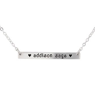 The Bar Necklace personalized hand stamped silver necklace with  kids names, shown close up on white