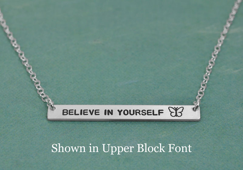 The Bar Necklace with butterfly stamp in upper block font