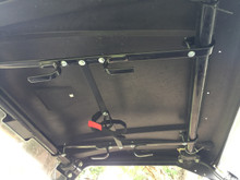 "Simply hook the 4 rubber coated hooks around the steel tubing cage bar overhead. The center flat steel is 18"" long"